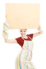 housewife holds wooden board with copy space