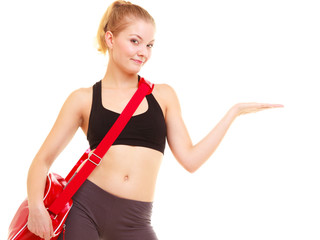 Sport. Fitness girl with gym bag showing copy space