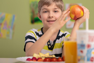 Boy eating fruits for lunch