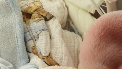 little newborn baby girl sleeping. Full HD motorized slider