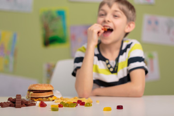 Eating gummy bears at school