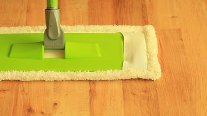 mop standing on wooden floor. Full Hd 1920X1080P