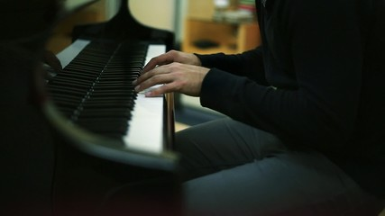 Musician's Hands as he Plays Piano in a Studio
