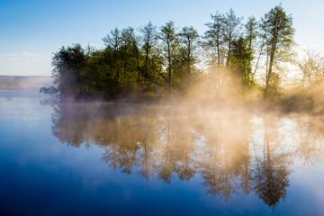 Morning fog on a calm river