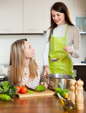 women cooking  together at domestic kitchen