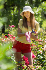 Happy female in yard gardening