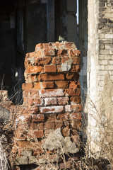fragment of an old brick building destroyed