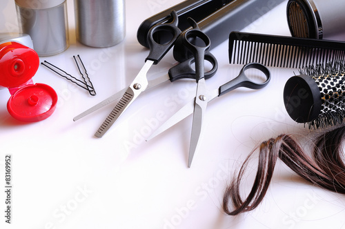 Set hairdressing articles on a white table composition Plakat