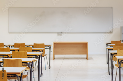 Plagát Desk and chairs in classroom