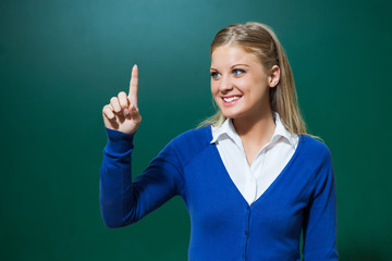 Young teacher pointing