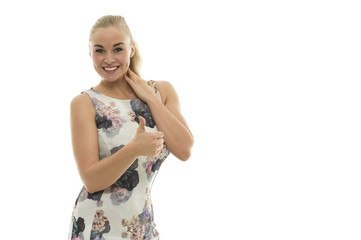 Enthusiastic young blond woman giving a thumbs up