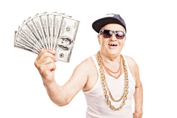 Toothless old man in hip-hop outfit holding cash