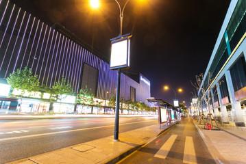 illuminated bus stop and street