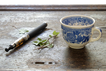 e-cigarette cup of coffee on a wooden background healthy