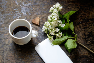 porcelain cup with coffee. lilac and a telephone