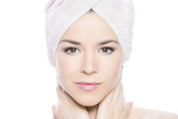 Beauty shot of a girl with a towel around her head