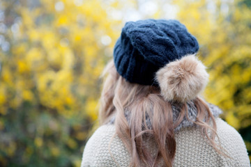 Woman back with wool hat