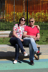 Couple hugging on a bench