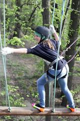 Girl climbing at adventure park