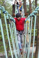 Happy man climber training