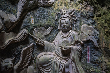 Sculpture of Buddha inside Am Phu Cave Danang