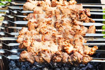 skewers with pork shish kebabs on roaster
