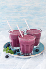 Blueberry smoothie with fresh berries and sprig of mint