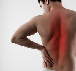 Back inflammation and ache. Young man having backbone disease