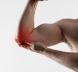 Man with chronic elbow pain. Closeup of male painful hand