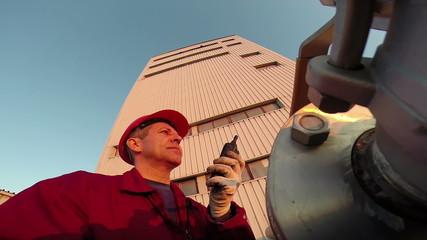 Industrial worker with walkie-talkie.HD1080p