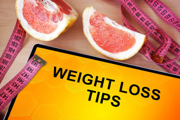 Tablet with weight loss tips. Weight loss concept.