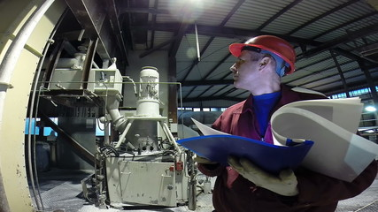 Engineer in manufacturing plant checking technical data.HD1080p