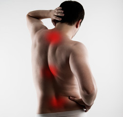 Reflexology. Spinal pain cure. Young male body with red points