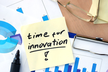 Paper with words time for innovation and charts.