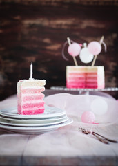 pink / white cake with cream cheese frosting.