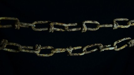Old rusty chain raised hands