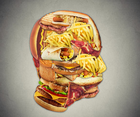 Unhealthy diet health concept fast food in shape of human head