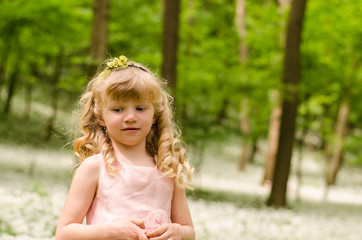 beautiful blond girl in woods