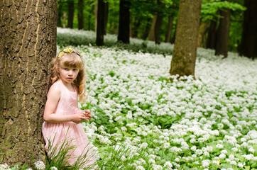 blond girl in spring woods