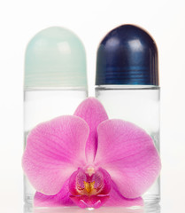 Ball deodorants and orchid flower