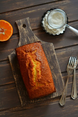 cake tangerine on a dark wooden surface
