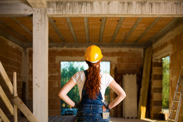Confident Woman Bricklayer with Her Hands on Hips