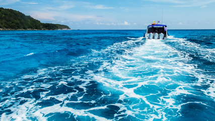 Boat Wake Prop Wash in Clear Blue Sea from Behind of Speed Boat
