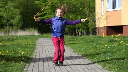 girl jumping rope in the park