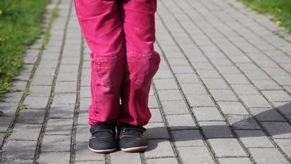 feet of little girl jumping rope