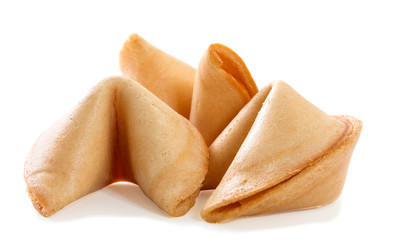 Chinese fortune cookie with blank paper strip isolated on white