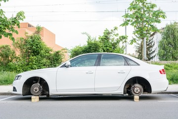 Car with stolen wheels