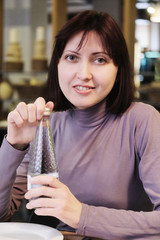 Woman opening a bottle of mineral water