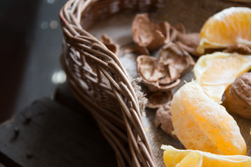 oranges and walnuts in a basket
