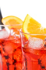 close-up of glasses spritz aperitif aperol cocktail and orange